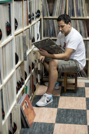 A Customer browsing through records at Centro Tropicalia Discos, Rio de Janeiro.